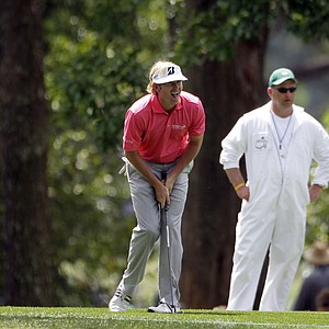 Brandt Snedeker watches his second shot on the first fairway during the first round of the Masters.
