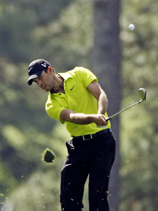 Charl Schwartzel, of South Africa, hits off the third fairway during the first round of the Masters.