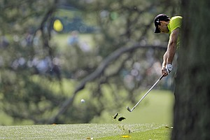 Charl Schwartzel, of South Africa, hits on the first hole during the first round the Masters.