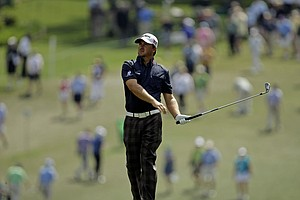 Graeme McDowell, of Northern Ireland, watches his second shot on the first fairway during the first round the Masters.