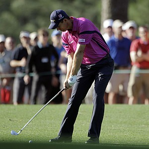 Padraig Harrington, of Ireland, hits on the first fairway during the first round of the Masters.