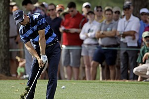 Henrik Stenson, of Sweden, takes his second shot on the first hole during the first round of the Masters.