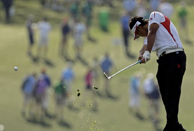 Amateur Hideki Matsuyama, of Japan, hits his second shot on the first fairway during the first round of the Masters.