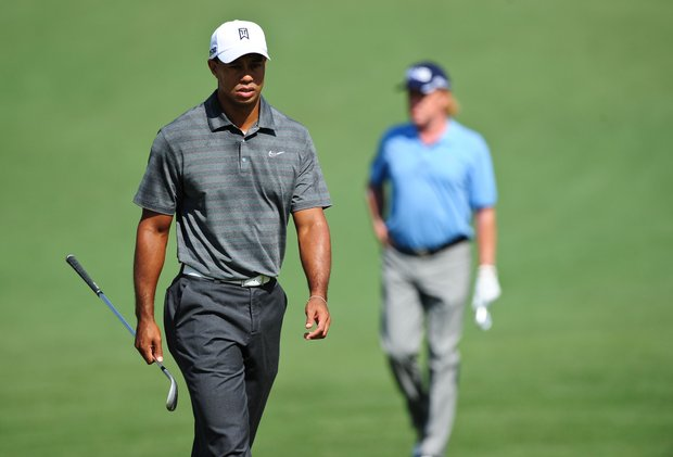 Tiger Woods (L) of the US and Miguel Angel Jimenez of Spain walk on the second fairway during the first round of the 76th Masters golf tournament at Augusta National.