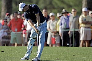 Martin Kaymer, of Germany, hits on the first fairway during the first round of the Masters.