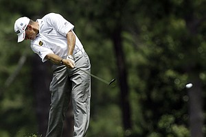 Lee Westwood, of England, hits off the second fairway during the first round the Masters.