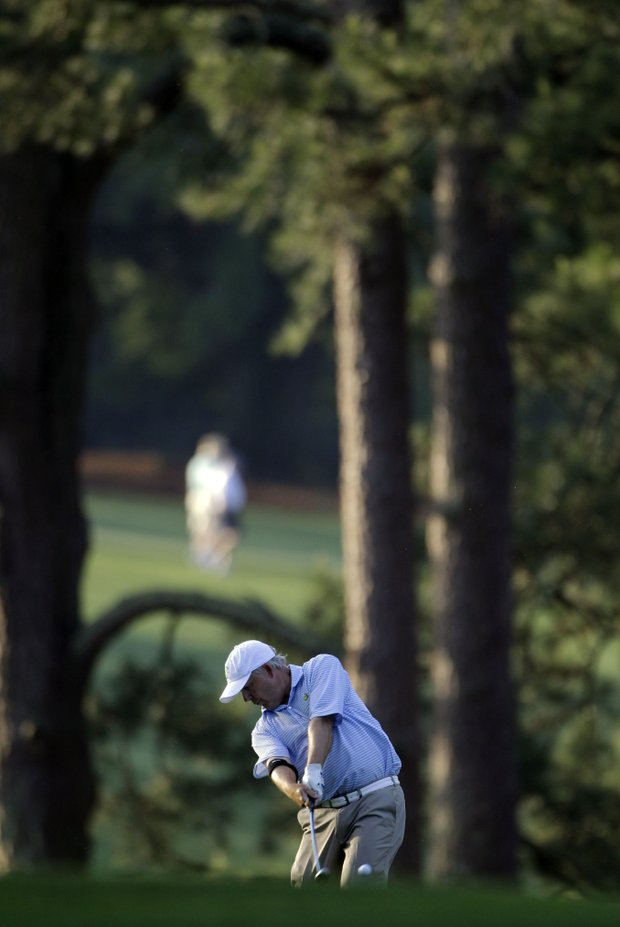 Amateur Randal Lewis hits on the first fairway during the first round of the Masters.