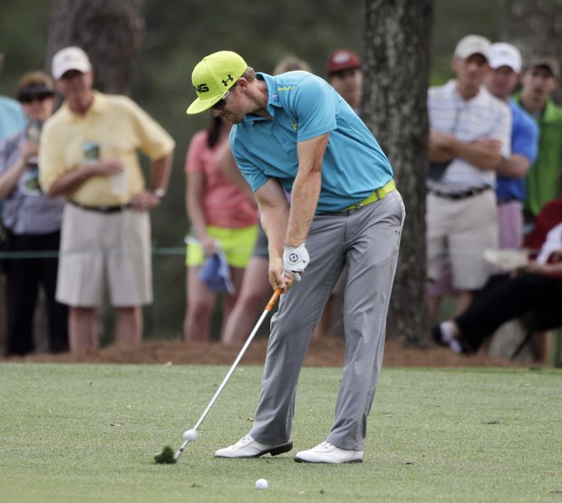 Hunter Mahan hits off the first fairway during the first round of the Masters.