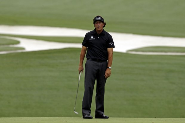 Phil Mickelson misses a putt on the 10th hole during the first round of the Masters.