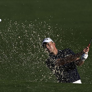 Robert Karlsson, of Sweden, chips to the second green during the first round the Masters.