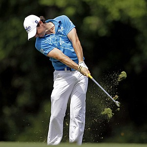 Rory McIlroy, of Northern Ireland, hits his second shot on the fifth fairway during the first round the Masters.