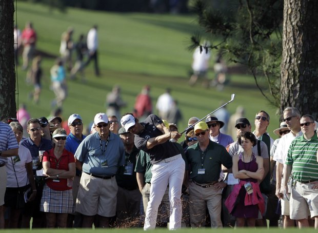 Adam Scott, of Australia, hits on the first fairway during the first round of the Masters.