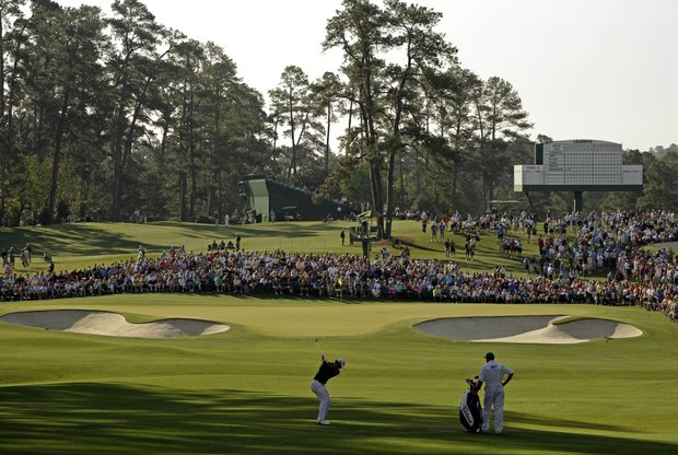 Adam Scott, of Australia, hits to the second green during the first round the Masters.