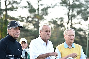 Honorary starters Gary Player (L) of South Africa, Arnold Palmer (C) and Jack Nicklaus of the US wait to tee off at Augusta National.