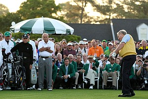 Honorary starter Jack Nicklaus hits a tee shot on the first hole as Arnold Palmer (C) and Gary Player of South Africa (L) to start the first round of the 2012 Masters Tournament at Augusta National.