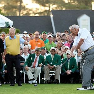 Honorary starter Arnold Palmer hits a tee shot as Gary Player (L) of South Africa and Jack Nicklaus (C) stand on the tee box at the start of the first round of the 2012 Masters Tournament at Augusta National.