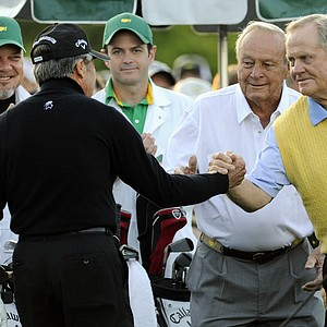 Honorary starters Arnold Palmer (C) of the US, Gary Player (L) of South Africa and Jack Nicklaus as they tee off at Augusta National.