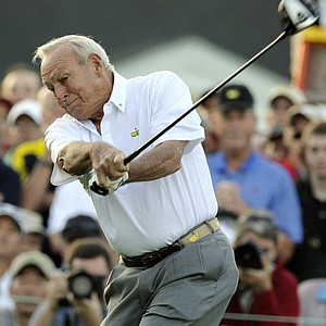 Honorary starter Arnold Palmer tees off at Augusta National.