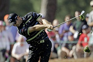 Trevor Immelman, of South Africa, hits his second shot on the first hole during the first round of the Masters.