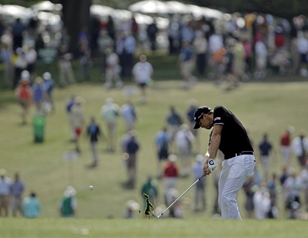 Nick Watney hits off the first fairway during the first round of the Masters.
