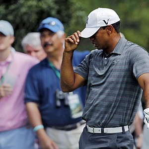 Tiger Woods reacts after his tee shot on the 15th hole during the first round of the Masters.