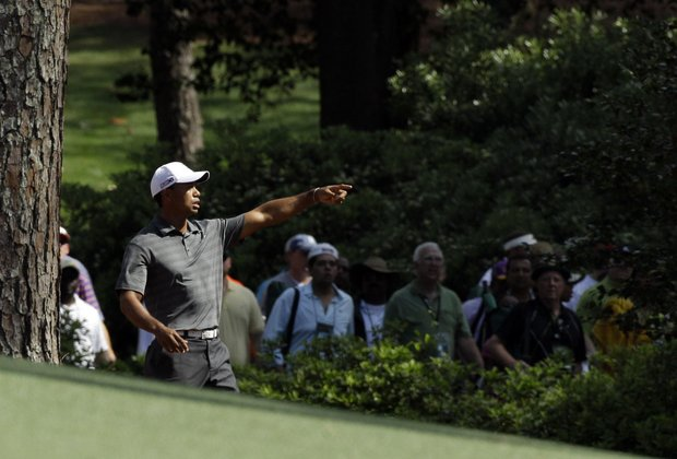 Tiger Woods tracks his ball after hitting off the second fairway during the first round the Masters.