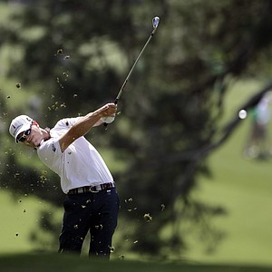 Zach Johnson hits his second shot on the second hole during the first round of the Masters.