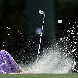 Jason Dufner hits out of a bunker on the 18th hole during the second round the Masters.