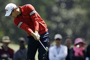 Sang-Moon Bae, of South Korea, hits off the first fairway during the second round the Masters.
