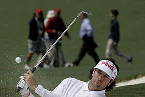 Bubba Watson hits out of a bunker on the ninth hole during the second round the Masters.