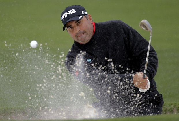 Angel Cabrera, of Argentina, hits out of a bunker on the second hole during the second round the Masters.