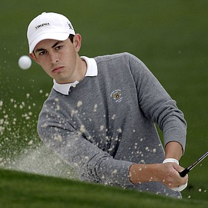 Amateur Patrick Cantlay chips out of a bunker on the second hole during the second round the Masters.