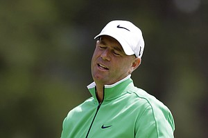 Stewart Cink reacts to a missed putt on the eighth hole during the second round of the Masters.