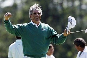 Fred Couples celebrates after finishing the second round the Masters.