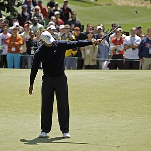 Tiger Woods holds up his putter after a birdie putt on the first hole during the second round the Masters.