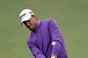 Graeme McDowell, of Northern Ireland, chips to the second fairway during the second round the Masters.