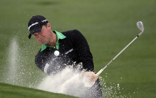 Peter Hanson, of Sweden, hits out of a bunker of the second hole during the second round the Masters.