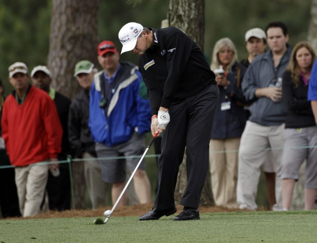 Paul Lawrie, of Scotland, hits off the first fairway during the second round the Masters.