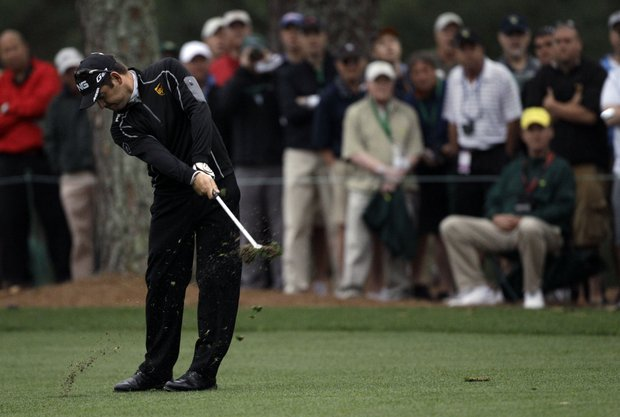 Louis Oosthuizen, of South Africa, hits off the first fairway during the second round the Masters.