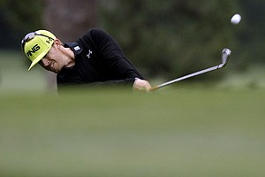 Hunter Mahan hits off the first fairway during the second round the Masters.