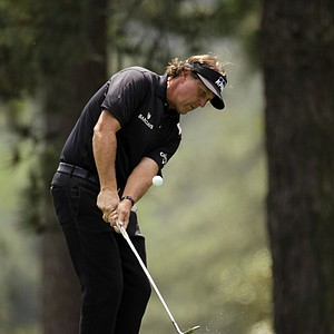 Phil Mickelson chips to the eighth green during the second round the Masters.