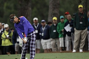Ian Poulter, of England, hits off the first fairway during the second round the Masters.