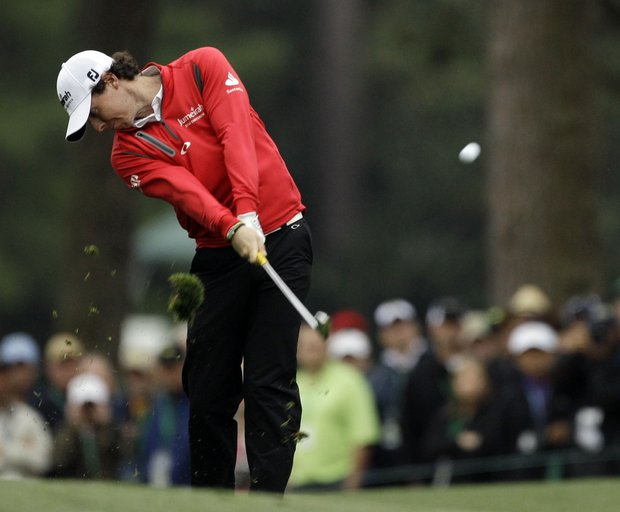 Rory McIlroy, of Northern Ireland, hits off the first fairway during the second round the Masters.