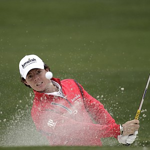 Rory McIlroy, of Northern Ireland, hits out of a bunker on the second hole during the second round the Masters.