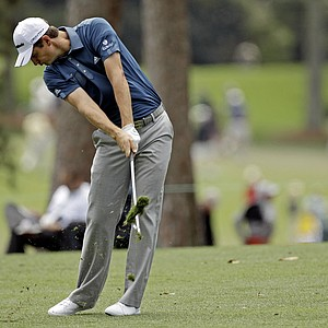 Justin Rose, of England, hits off the first fairway during the second round the Masters.