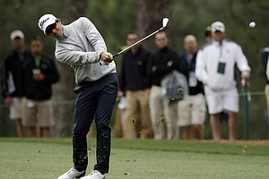 Adam Scott, of Australia, hits off the first fairway during the second round the Masters.