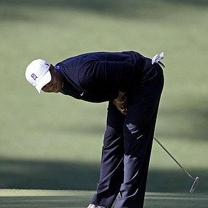 Tiger Woods reacts to a missed birdie putt on the 10th green during the second round of the Masters.