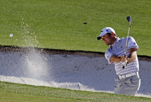 Trevor Immelman, of South Africa, hits out of a bunker on the 17th hole during the second round of the Masters.