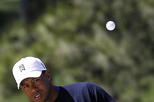 Tiger Woods chips to the seventh hole during the second round the Masters.