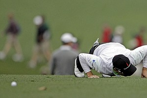 Zach Johnson checks for his ball on the first fairway during the second round the Masters.